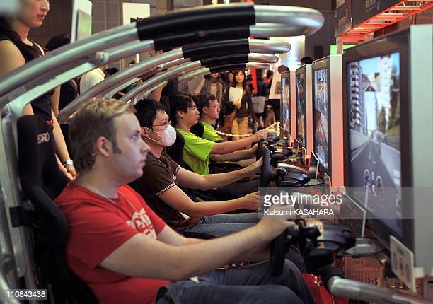 Tokyo Game Show In Tokyo Japan On September 24 2009 Visitors control driving games at Sony's ' Play Station ' booth during Tokyo Game Show 2009 at...