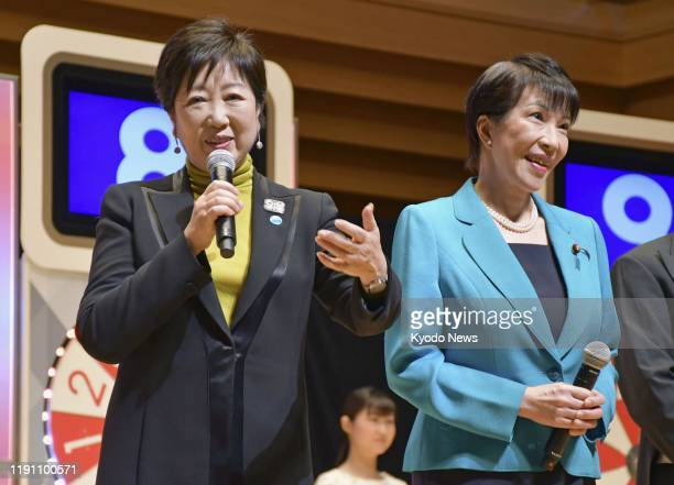 Tokyo Gov. Yuriko Koike and Sanae Takaichi, minister of internal affairs and communications, attend a ceremony for the Year-end Jumbo lottery draw in...