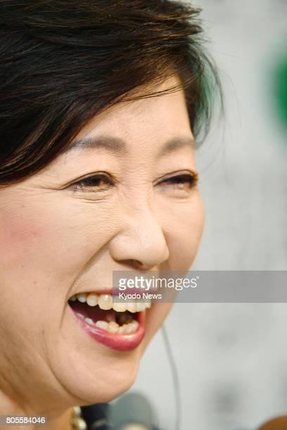 Tokyo Gov Yuriko Koike is all smiles at the election results center of her Tomin First no Kai in Tokyo on July 2 2017 The new party and forces close...