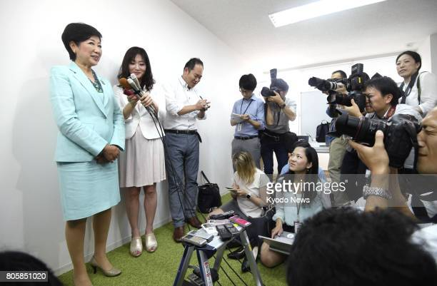 Tokyo Gov Yuriko Koike meets with reporters in Tokyo on July 3 a day after her new party Tomin First no Kai and allies scored a sweeping victory in...