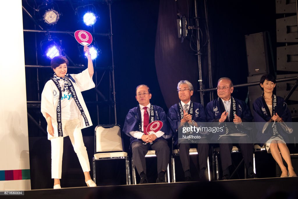 Tokyo Gov. Yuriko Koike waves to public before her speech with the hosts and guests (sitting from Left to right) Toshiro Muto, Tsunekazu Takeda, Mitsunori Torihara, Tamayo Marukawa, during the Tokyo 2020 flag tour festival for the 2020 Games at Tokyo Metropolitan Plaza in Tokyo, July 24, 2017. Japan began its three-year countdown for the Tokyo 2020 Summer Olympics in Tokyo on Monday with image projection-mapping beamed on a building of Tokyo Metropolitan Government Office. The 2020 Games will be Japan's first summer Olympics since the 1964.