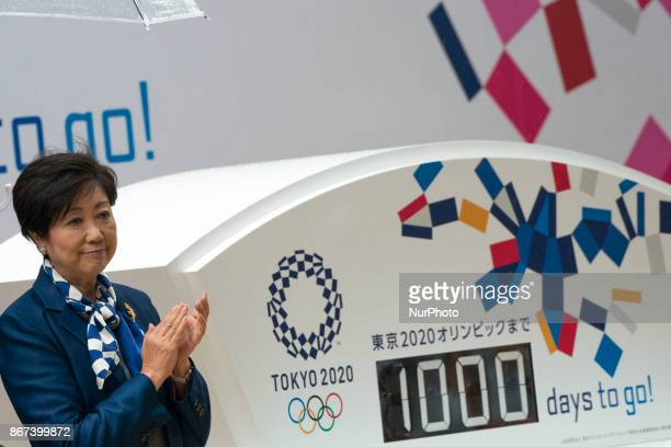 Tokyo Governor and head of Party of Hope Yuriko Koike claps her hands as she attend an unveiling the display counting down the days to the beginning...
