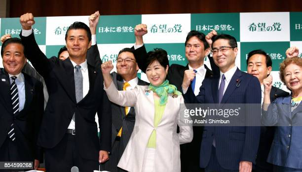 Tokyo Governor and new party 'Kibo no To ' leader Yuriko Koike and party members raise their fists during the party establishment ceremony on...