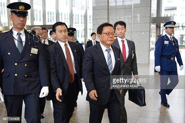 Tokyo governor Naoki Inose arrives at the Metropolitan Government Building in Tokyo on December 19 2013 Embattled Tokyo governor Naoki Inose is set...