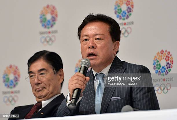 Tokyo Governor Naoki Inose speaks while Olympic bid committee CEO Masato Mizuno looks on during a press conference at the Tokyo city hall on...