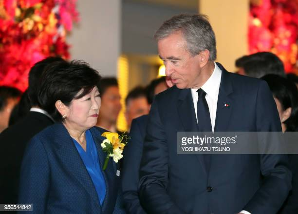 Tokyo Governor Yuriko Koike chats with LVMH group CEO Bernard Arnault at the opening ceremony of Tokyo's new landmark Ginza Six in Tokyo's Ginza...