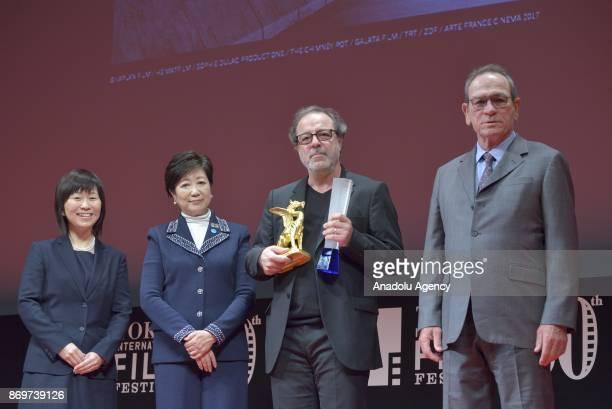Tokyo Governor Yuriko Koike President of Jury Tommy Lee Jones and Turkish movie Director Semih Kaplanoglu poses with the Tokyo Grand Prix and The...