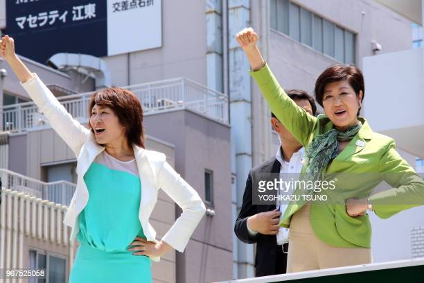 Tokyo Governor Yuriko Koike raises her fist with her party 'Tomin First no Kai' candidate as she delivers a campaign speech for the upcoming Tokyo...