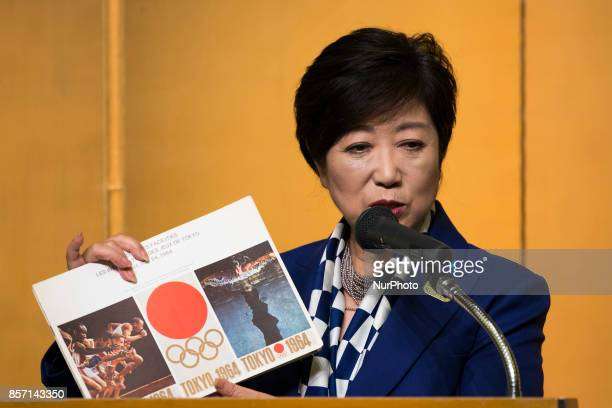 Tokyo Governor Yuriko Koike shows a book about the 1964 Tokyo Olympics during the Project Review meeting between the International Olympic Committee...