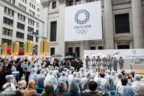 Tokyo Governor Yuriko Koike Tokyo 2020 Chief Executive Officer Toshiro Muto second from right and Japanese Olympic Committee President Tsunekazu...