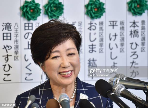 Tokyo Governor Yuriko Koike who currently is the leader of the newlyformed Tomin First no Kai party smiles during a television interview in Tokyo on...