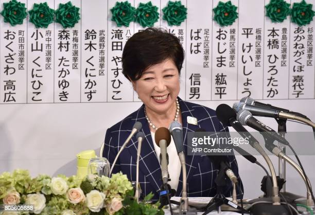 Tokyo Governor Yuriko Koike who currently is the leader of the newlyformed Tomin First no Kai party smiles as she holds a press conference in Tokyo...