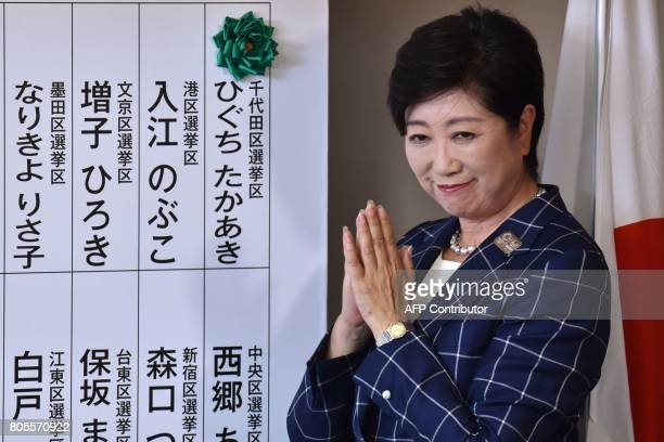 Tokyo Governor Yuriko Koike who is the current leader of the newlyformed Tomin First no Kai party gestures beside a green 'rose' used to mark the...