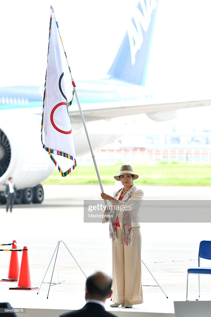 Tokyo Governor Yuriko Koike with the Olympic flag during the 'The Arrival of Olympic Flag Ceremony' at Haneda Airport on August 24, 2016 in Tokyo, Japan.