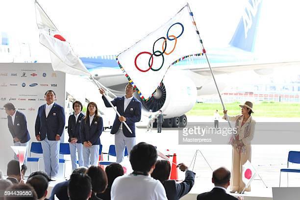 Tokyo Governor Yuriko Koike with the Olympic flagand Rio de Janeiro Olympic Japan squad Subcaptain Keisuke Ushiro the JOC flag waves during the 'The...