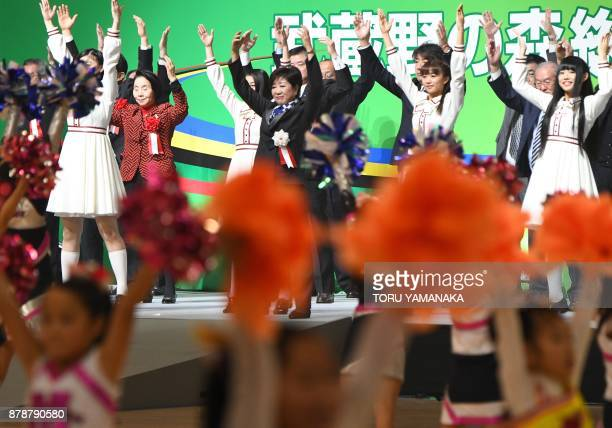 Tokyo Governor Yuriko Koike works out with other attendants during the opening ceremony for Musashino Forest Sports Plaza in Tokyo on November 25,...