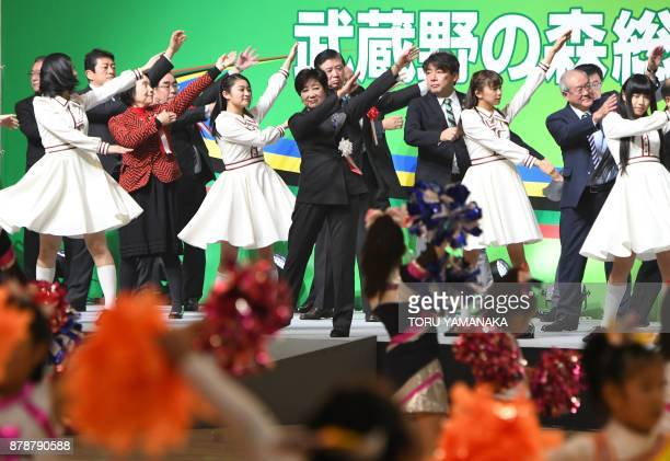 Tokyo Governor Yuriko Koike works out with other attendants during the opening ceremony for Musashino Forest Sports Plaza in Tokyo on November 25...