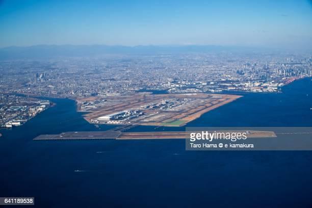 Tokyo Haneda International Airport daytime aerial view from airplane