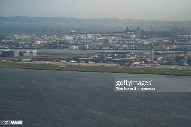tokyo haneda international airport in japan daytime aerial view from airplane - 川崎市 ストックフォトと画像