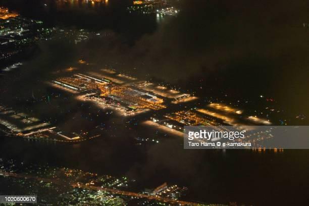 Tokyo Haneda International Airport in Japan night time aerial view from airplane