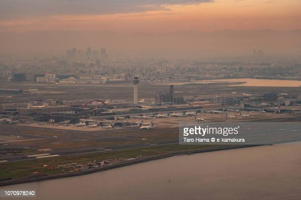 Tokyo Haneda International Airport (HND) in Japan sunset time aerial view from airplane