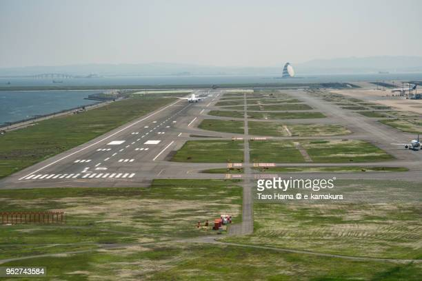tokyo haneda international airport in tokyo in japan daytime aerial view from airplane - utc−10:00 stock pictures, royalty-free photos & images