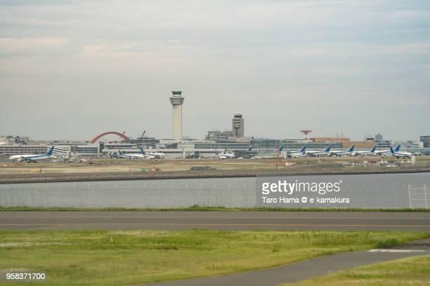 Tokyo Haneda International Airport in Tokyo in Japan daytime aerial view from airplane