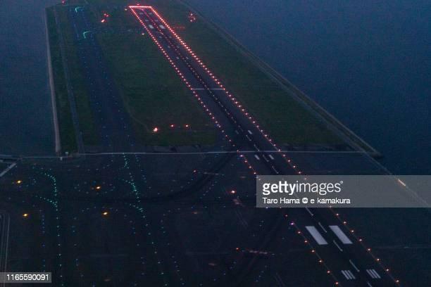 tokyo haneda international airport in tokyo night time aerial view from airplane - taro hama ストックフォトと画像
