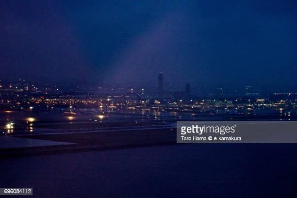Tokyo Haneda International Airport night time aerial view from airplane