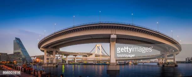 Tokyo harbour Rainbow Bridge curving over bay to Odaiba Japan