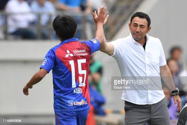 Tokyo head coach Kenta Hasegawa and Takefusa Kubo shake hands during the J.League J1 match between FC Tokyo and Jubilo Iwata at Ajinomoto Stadium on...