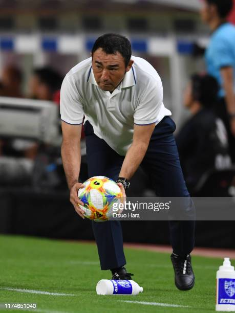 Tokyo head coach Kenta Hasegawa looks on during the J.League J1 match between Kashima Antlers and FC Tokyo at Kashima Soccer Stadium on September 14,...