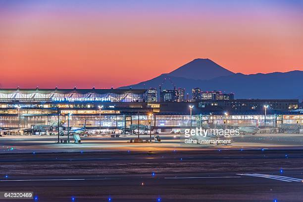 tokyo international airport after sunset - haneda tokyo stock photos and pictures