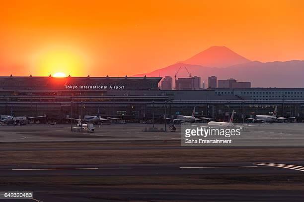 Tokyo International Airport at sunset with Mt Fuji