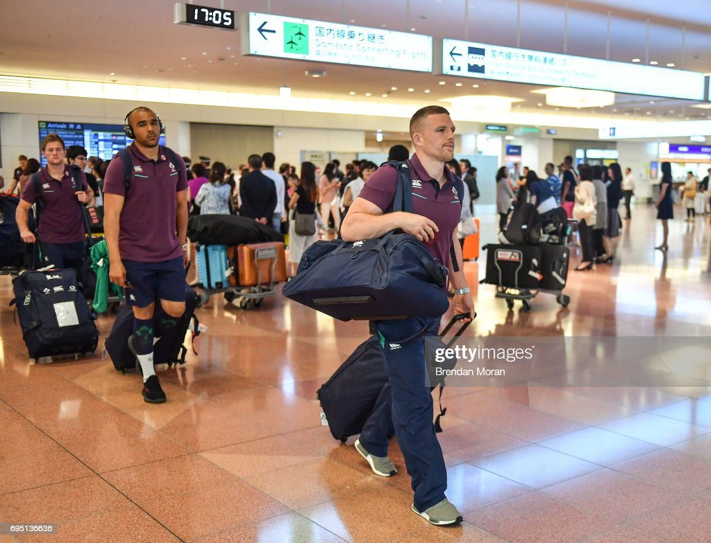 Tokyo , Japan - 12 June 2017; Andrew Conway of Ireland, right, followed by team-mates Simon Zebo and Kieron Marmion, on arrival into Haneda Airport in Tokyo, Japan, ahead of their 2 test matches against Japan.