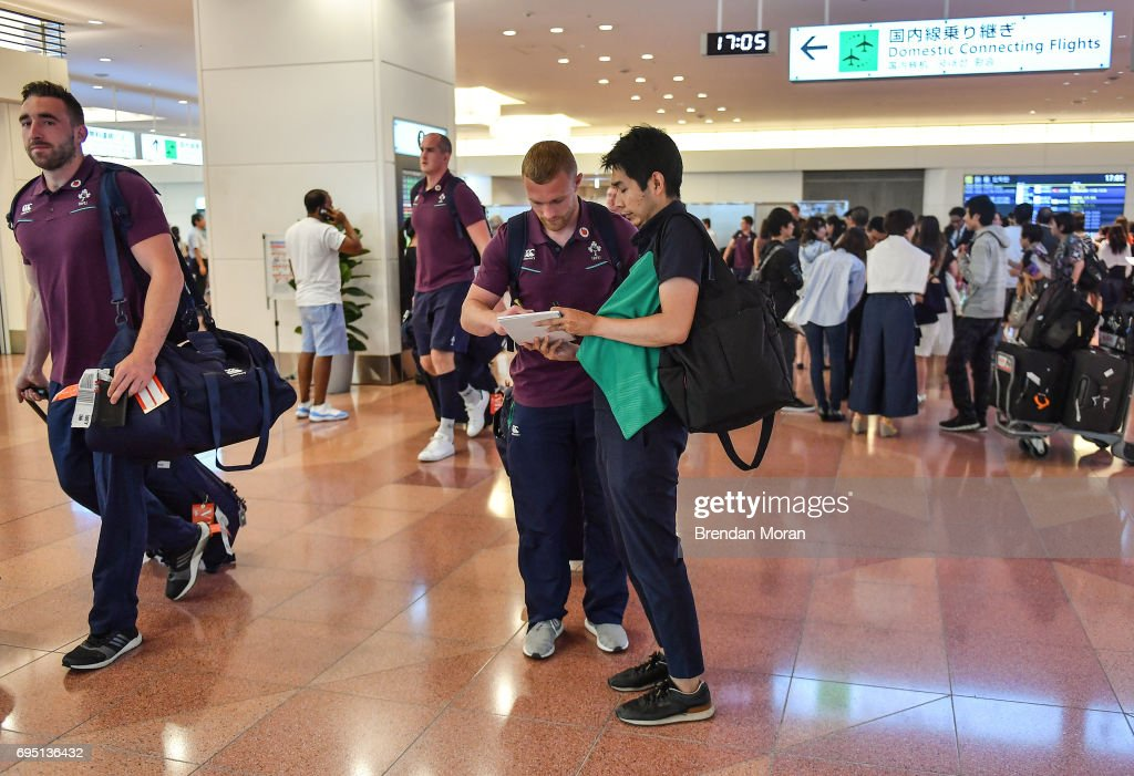 Tokyo , Japan - 12 June 2017; Keith Earls of Ireland signs an autograph on arrival into Haneda Airport in Tokyo, Japan, ahead of their 2 test matches against Japan.