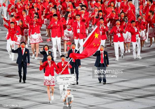 Tokyo , Japan - 23 July 2021; Team China flagbearers Ting Zhu and Shuai Zhao carry the Chinese flag during the 2020 Tokyo Summer Olympic Games...