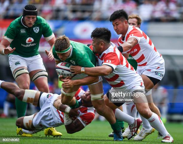 Tokyo , Japan - 24 June 2017; Josh van der Flier of Ireland is tackled by Michael Leitch, left, and Takuma Asahara of Japan during the international...