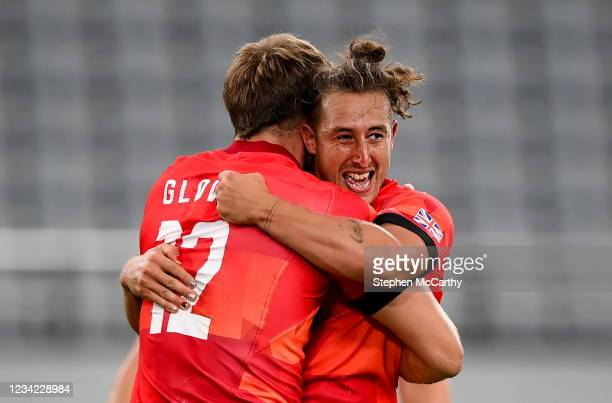 Tokyo , Japan - 27 July 2021; Dan Bibby and Harry Glover, left, of Great Britain celebrate following the Men's Rugby Sevens quarter-final match...