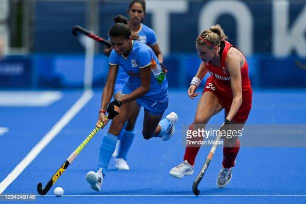 Tokyo , Japan - 28 July 2021; Devi Sharmila of India in action against Lily Owsley of Great Britain during the women's pool A group stage match...