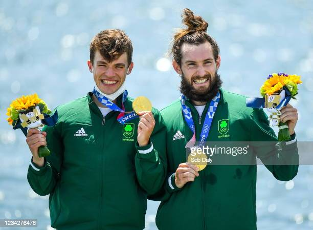 Tokyo , Japan - 29 July 2021; Fintan McCarthy, left, and Paul O'Donovan of Ireland celebrate with their gold medals after winning the Men's...