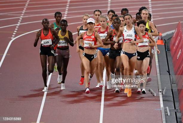 Tokyo , Japan - 30 July 2021; Athletes pass a loose piece of metal on the track during round 1 of the women's 5000 metres at the Olympic Stadium...