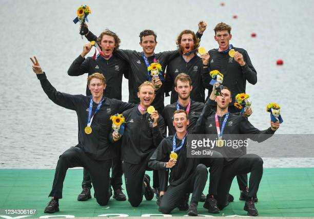 Tokyo , Japan - 30 July 2021; New Zealand Men's Eight celebrates with their gold medals after vicotry in the Men's Eight final at the Sea Forest...