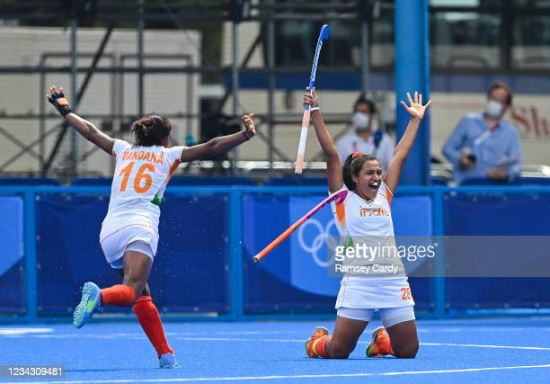 Tokyo , Japan - 30 July 2021; Rani of India, right, celebrates with team-mate Vandana Katariya, left, after assisting their side's first goal during...