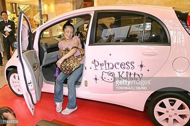 A customer checks a Mitsubishi Motors minicar 'i' with Helllo Kitty design and equipped with a 660cc engine during a Hello Kitty event at Tokyo's...