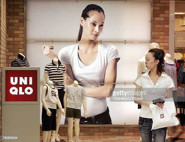 A customers passes before a Uniqlo shop Japan's casual wear giant operated by the Fast Retailing in Tokyo 06 July 2007 Fast Retailing offered 900...