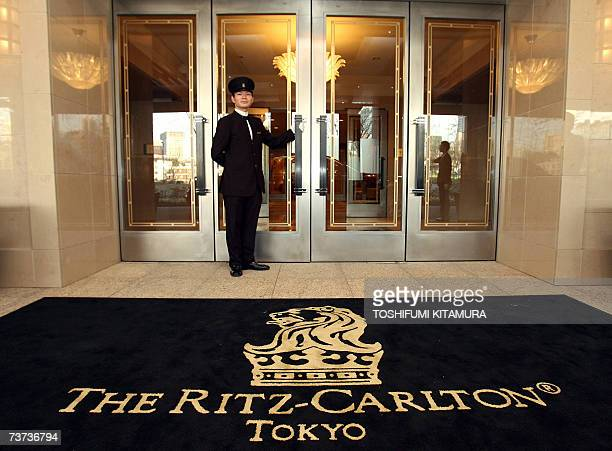 Doorman stands at the main entrance of the Ritz-Carlton during its press preview in Tokyo, 29 March 2007. The latest and most pricey hotel, the...