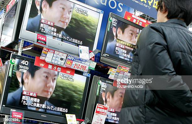 A man looks at television news reporting former Livedoor Co President Takafumi Horie at an electronic shop in Tokyo 16 March 2007 A Japanese court...