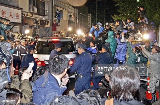 A minivan carrying Takafumi Horie the founder of Japan's scandalhit Livedoor Internet firm leaves Tokyo detention center 27 April 2006 as Horie...
