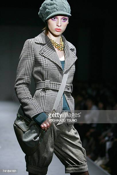 A model displays a glen checked woolen short coat with woolen half pants at the Italian casual brand Benetton's fall and winter collection in Tokyo...